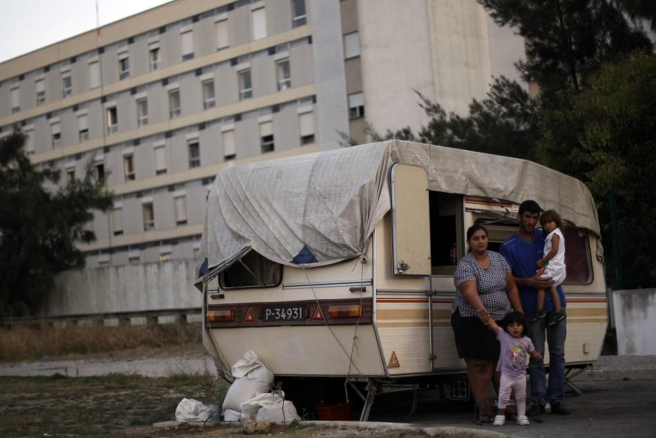 The Silva family in front of their trailer home, before being evicted