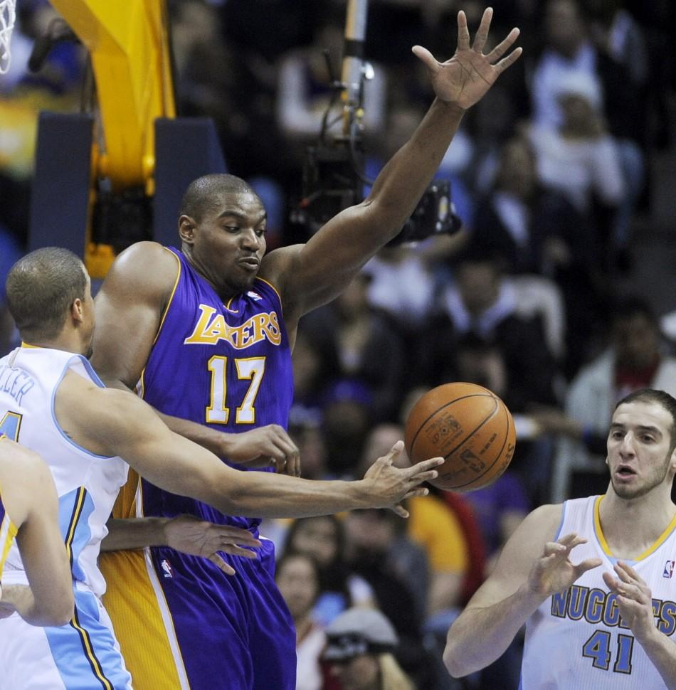 Los Angeles Lakers center Andrew Bynum defends a pass by the Denver Nuggets Andre Miller (L) to Kosta Koufos (R) during the second quarter of play in their NBA basketball game in Denver