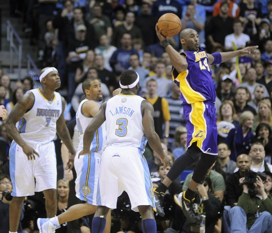 Los Angeles Lakers guard Kobe Bryant jumps with the ball during the Lakers 93-89 win over the Denver Nuggets in their NBA basketball game in Denver