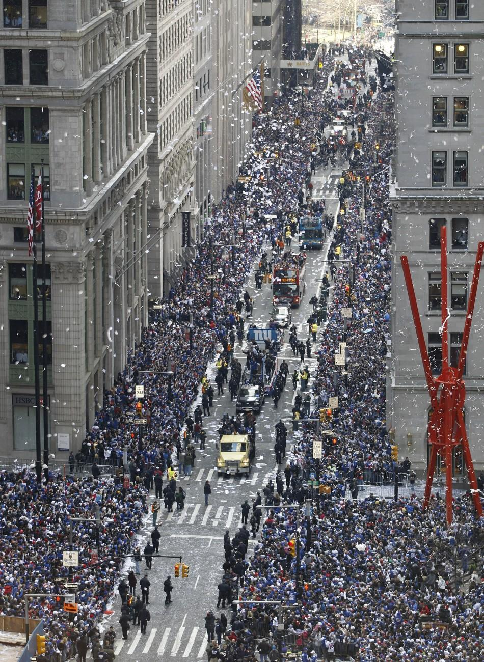 Streamers and confetti rain down on the New York Giants Super Bowl XLVI victory parade through the Canyon of Heroes along Broadway in New York