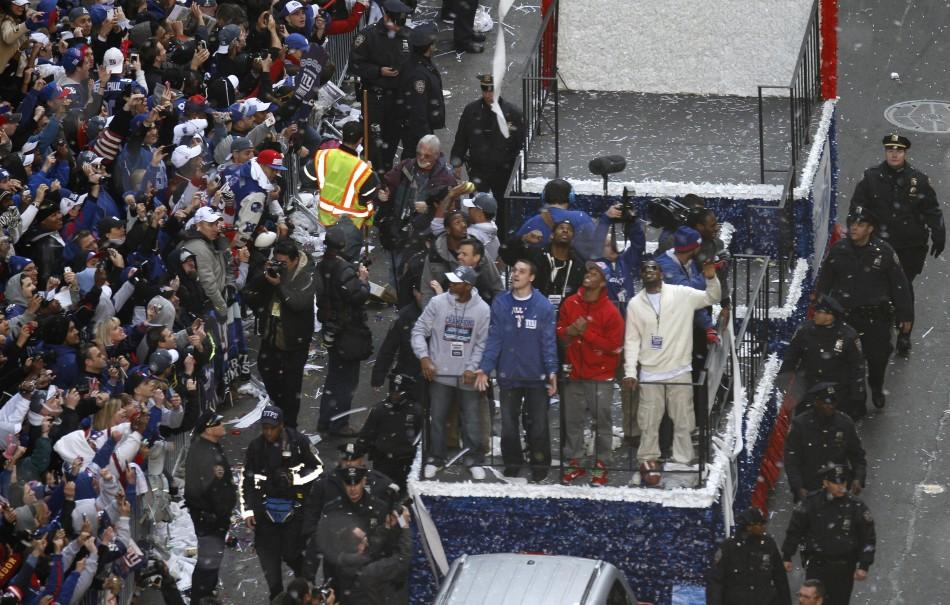Confetti rain down on the New York Giants Super Bowl XLVI victory parade through the Canyon of Heroes along Broadway in New York