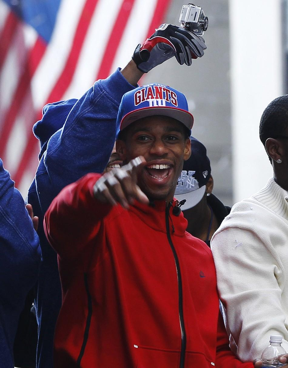 New York Giants wide receiver Victor Cruz celebrates during the team's ticker tape Super Bowl victory parade through the Canyon of Heroes along Broadway in New York