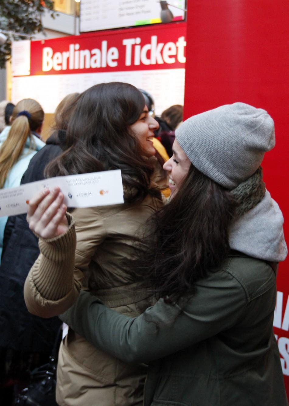 "People react after buying tickets for the movie ""Don - The King is back"" at the upcoming 62nd Berlinale International Film Festival in Berlin February 6, 2012. The February 9-19 Berlinale kicks off the European festival season. ""Don - The K"