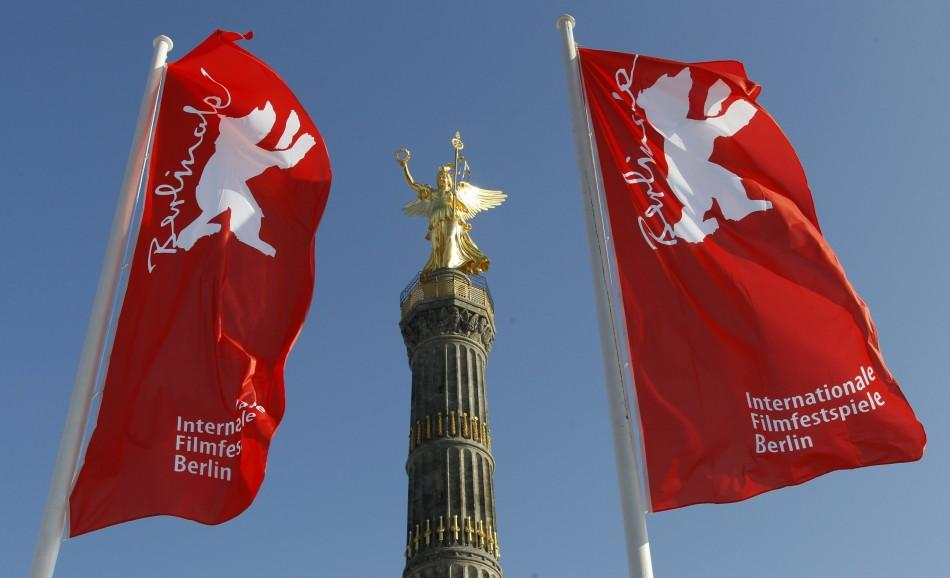 Flags advertising the 62nd Berlinale International Film Festival flutter next to the victory column in Berlin February 6, 2012. The February 9-19 Berlinale kicks off the European festival season.