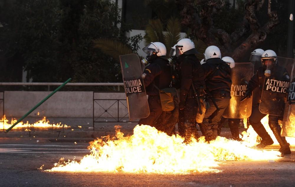 Greece: A gasoline bomb thrown by protesters explodes over riot-control officers