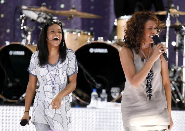 Singer Houston performs with her daughter Kristina during a taping of Good Morning America on ABC in New York