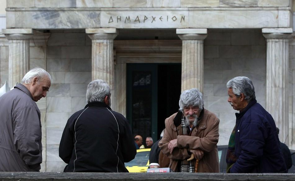 Retirees gather in front of the Athens town hall Tuesday, in support of further anti-austerity rallies, two days after violent riots shook the city.