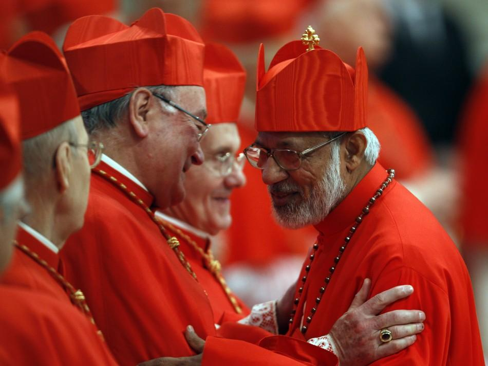 New Cardinal George Alencherry (R) of India talks with Cardinal Timothy Dolan (R) of the U.S. during a consistory ceremony in Saint Peter's Basilica