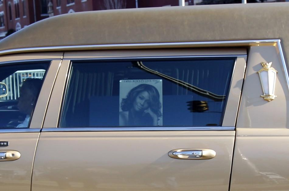Picture of Houston is seen on window of the hearse carrying late singer to the New Hope Baptist Church for her funeral service in Newark