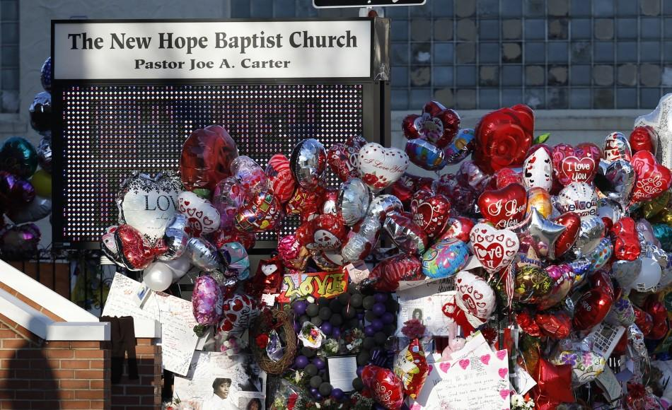Floating balloons are seen before the funeral service of pop singer Houston, at the New Hope Baptist Church in Newark