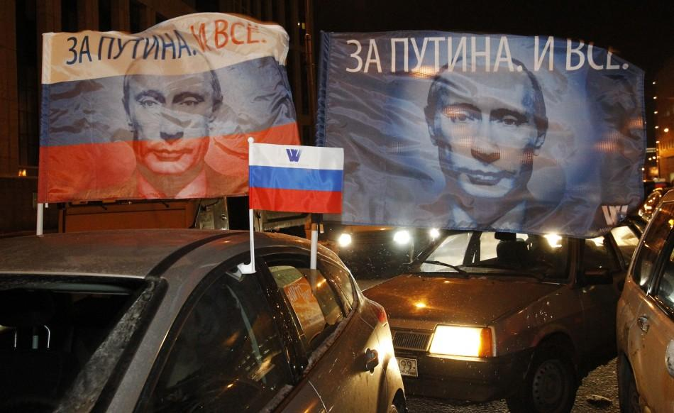 Flags with portraits of Russian Prime Minister Vladimir Putin are displayed during a car rally to show support for Putin's presidential candidacy in Moscow Feb. 18, 2012. Russia will go to the polls for a presidential election on March 4.