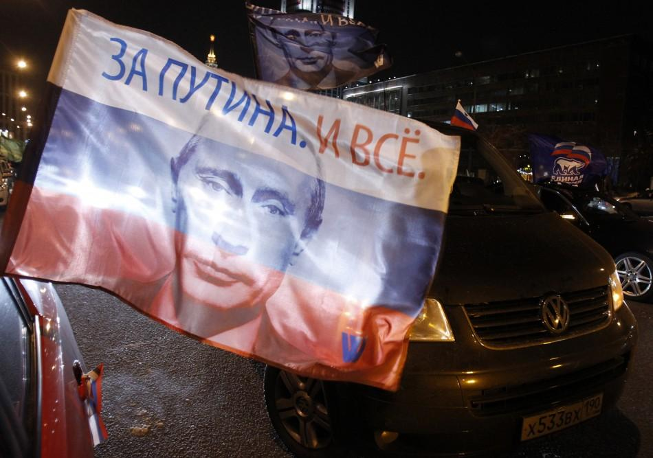 Cars showing flags with portraits of Russian Prime Minister Vladimir Putin gather during a car rally to show support for Putin's presidential candidacy in Moscow Feb. 18, 2012. Russia will go to the polls for a presidential election on March 4. T