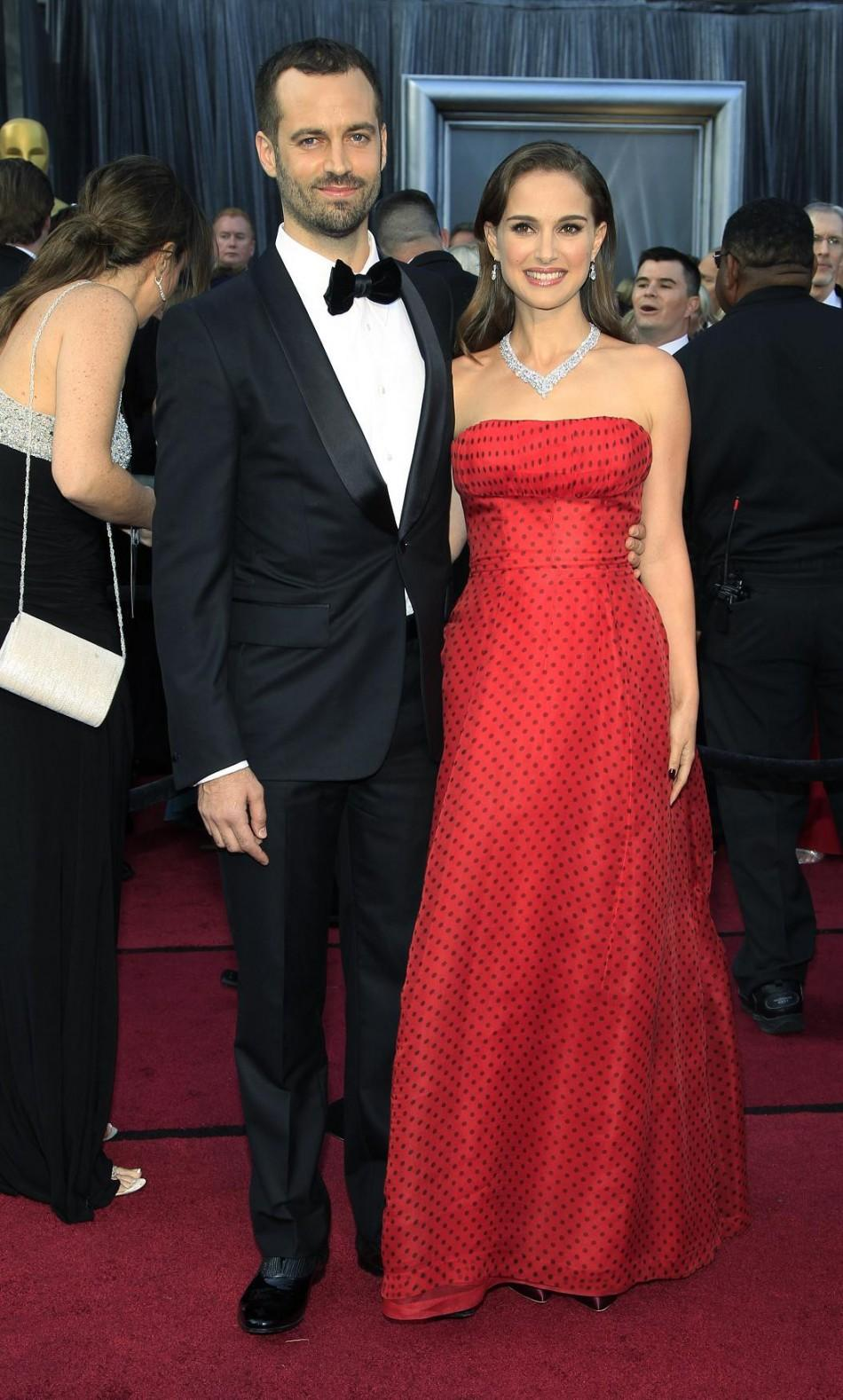 Benjamin Millepied and actress Natalie Portman arrive at the 84th Academy Awards in Hollywood.