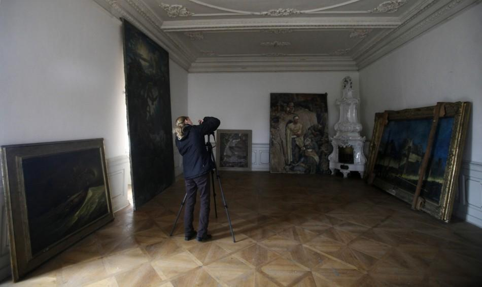 A photographer takes pictures of paintings at the Doksany Monastery near Prague
