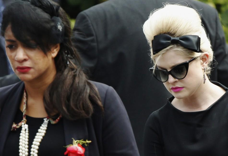 Kelly Osbourne leaves Golders Green Crematorium with other mourners after the cremation of British singer Amy Winehouse, in north London
