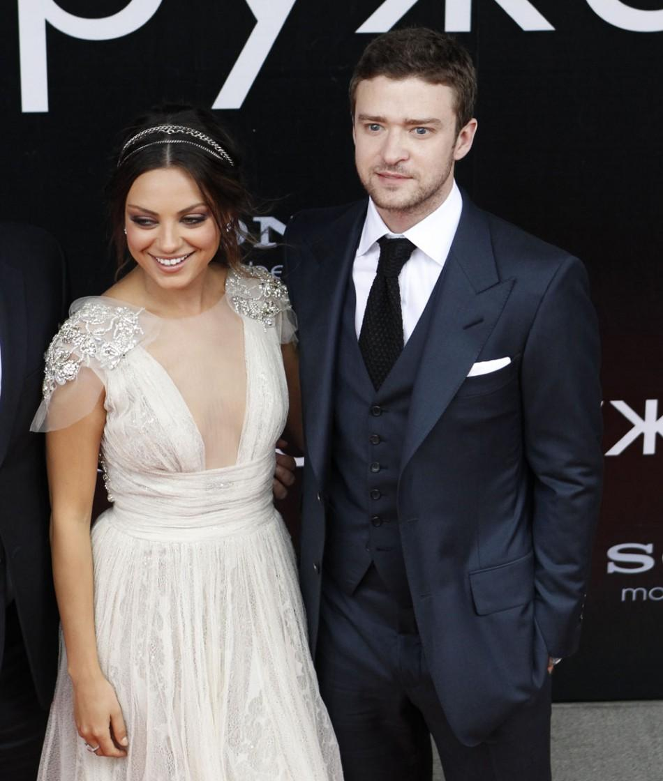 Actors Justin Timberlake (R) and Mila Kunis in Moscow