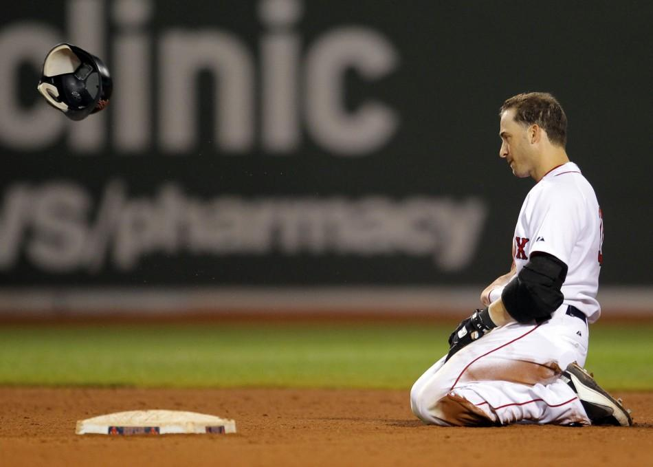 Red Sox' Scutaro tosses his helmet after being tagged out at second base to end the 12th inning of their MLB American League baseball game against the Kansas City Royals at Fenway Park in Boston