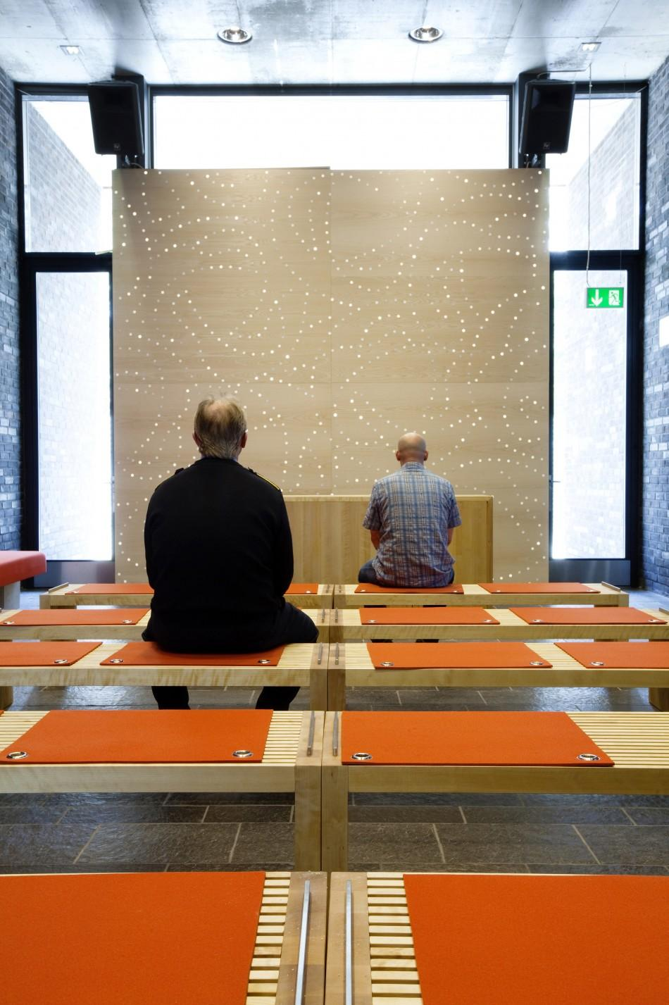 Two men sit inside the chapel at Halden prison in the far southeast of Norway in this picture taken in 2010