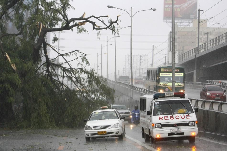 A Slow Moving Tropical Storm whrilwind out Philippnes(PHOTOS )