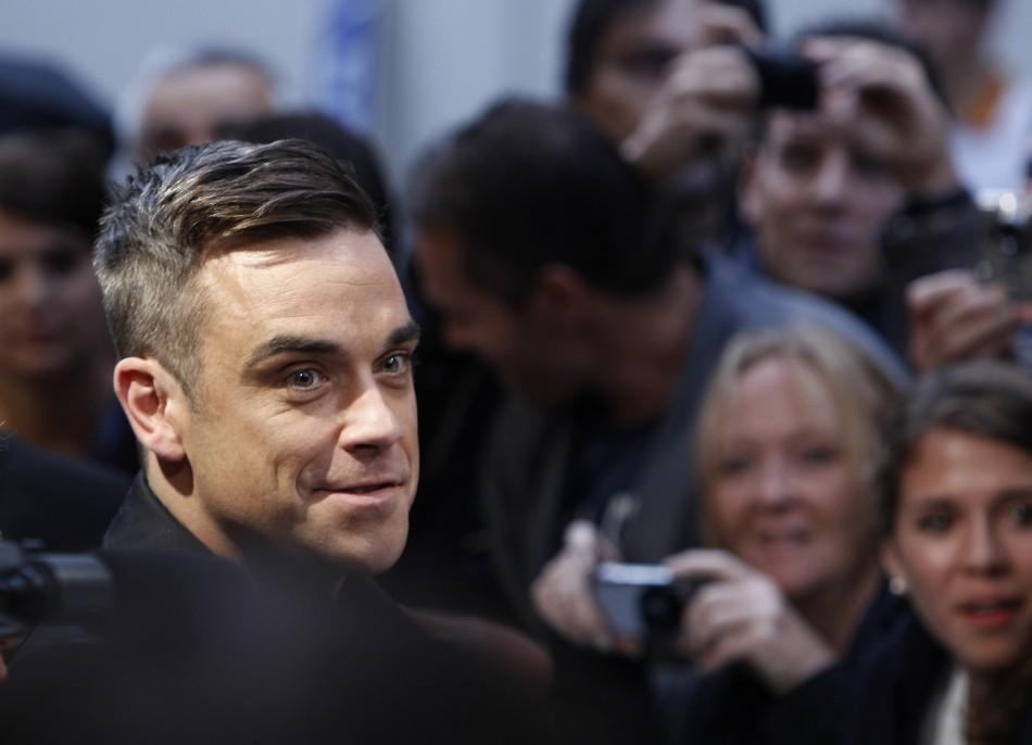 "British singer Robbie Williams arrives on the red carpet for the German premiere of ""Cars 2"" in Munich"