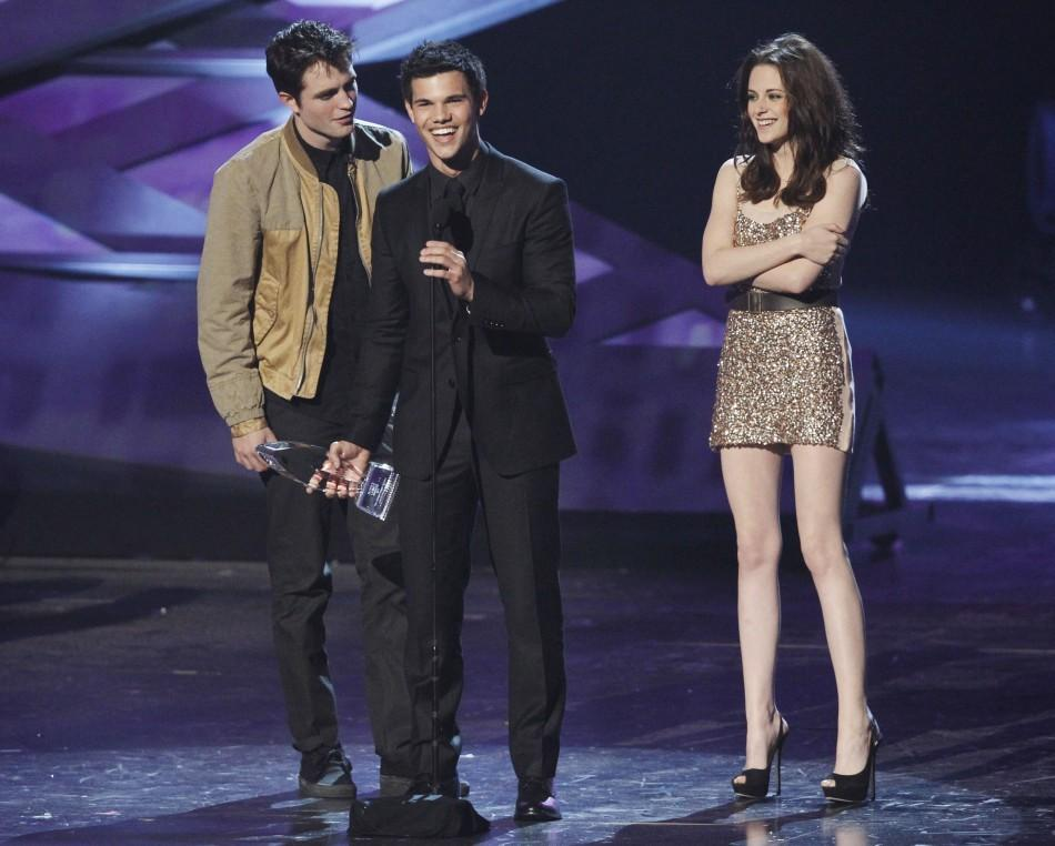 Actors Pattinson, Lautner and Stewart accept the favorite movie award for 'The Twilight Saga: Eclipse' at the 2011 People's Choice Awards in Los Angeles