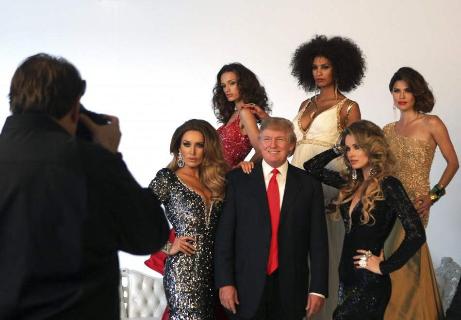 Trump poses with former Miss Universe Beauty Queens during a pageant photoshoot in New York