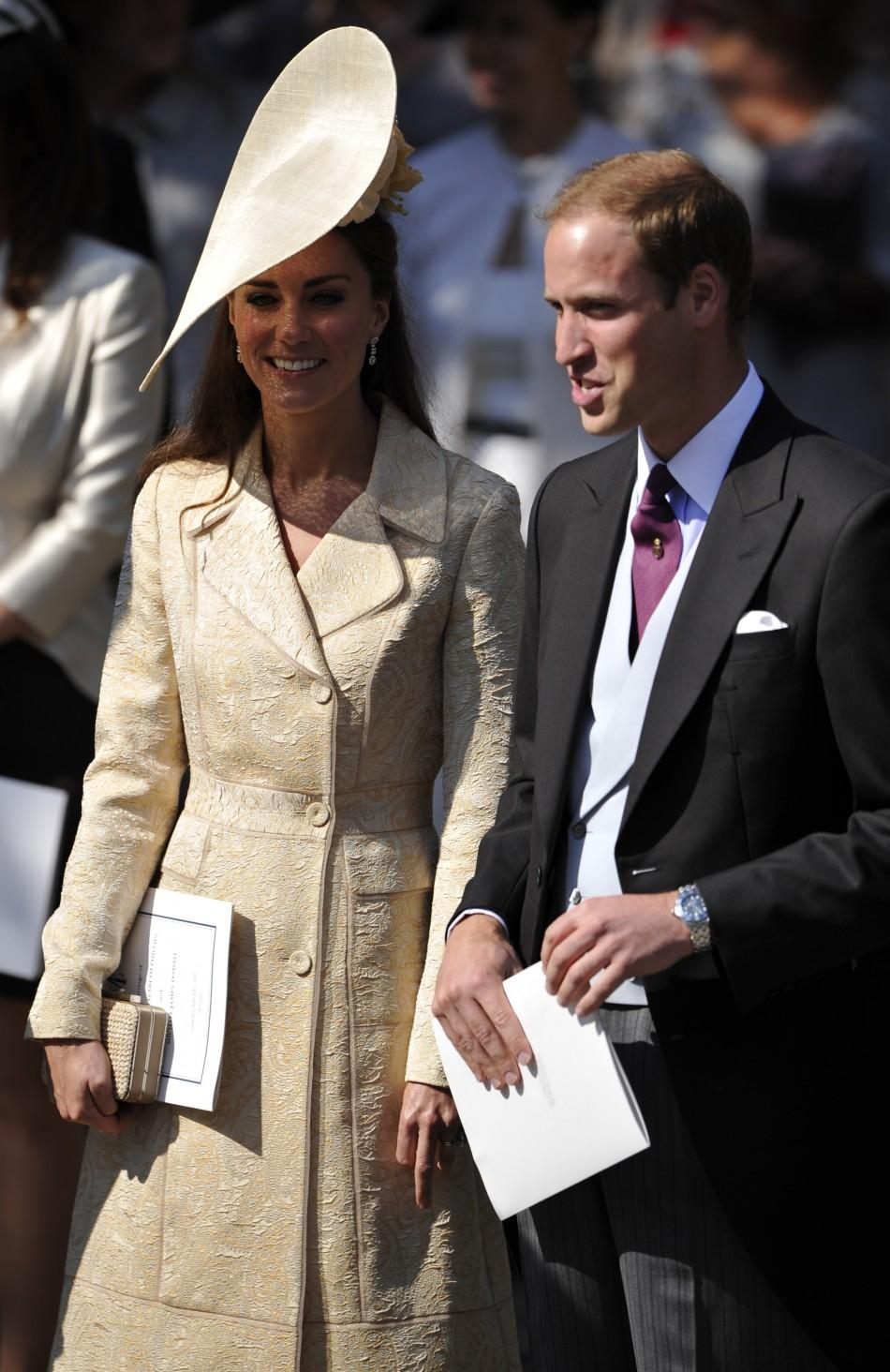 Catherine Duchess of Cambridge and Prince William leave after the marriage of Britain's Zara Phillips and Mike Tindall at Canongate Kirk in Edinburgh