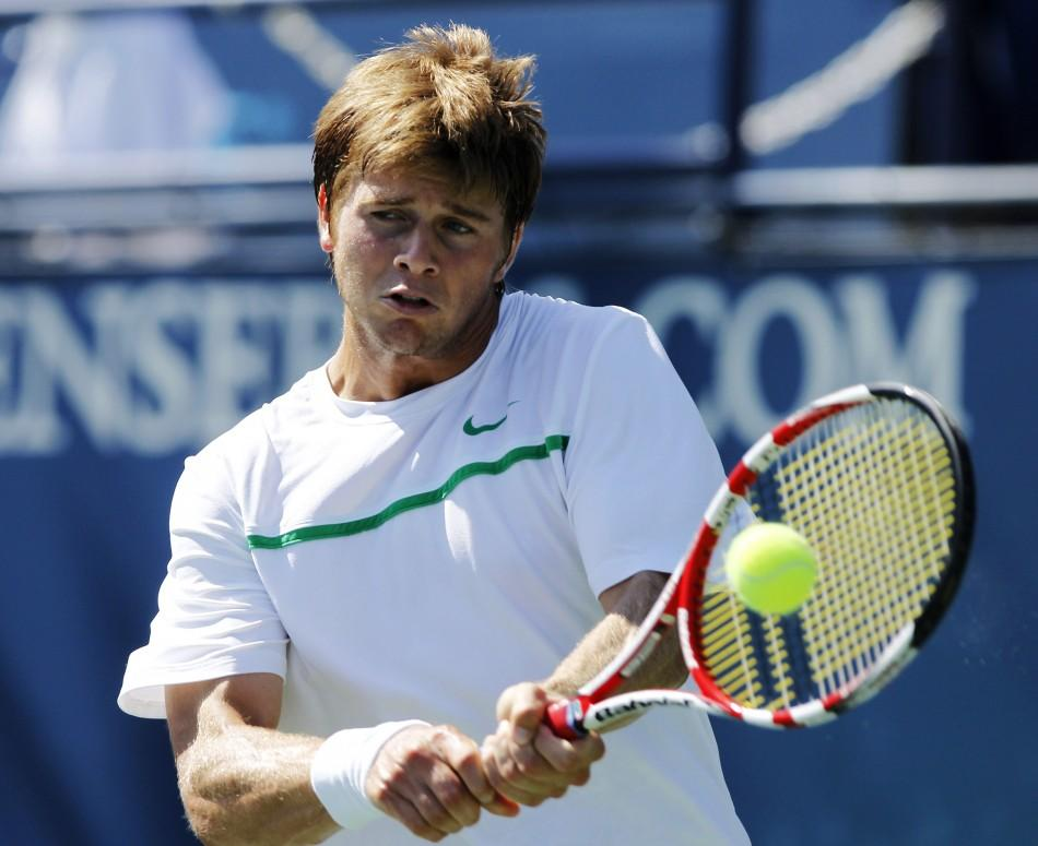 Ryan Harrison of the U.S. hits a backhand to compatriot Mardy Fish during the semi-finals of the ATP Los Angeles International tennis open tournament in Los Angeles