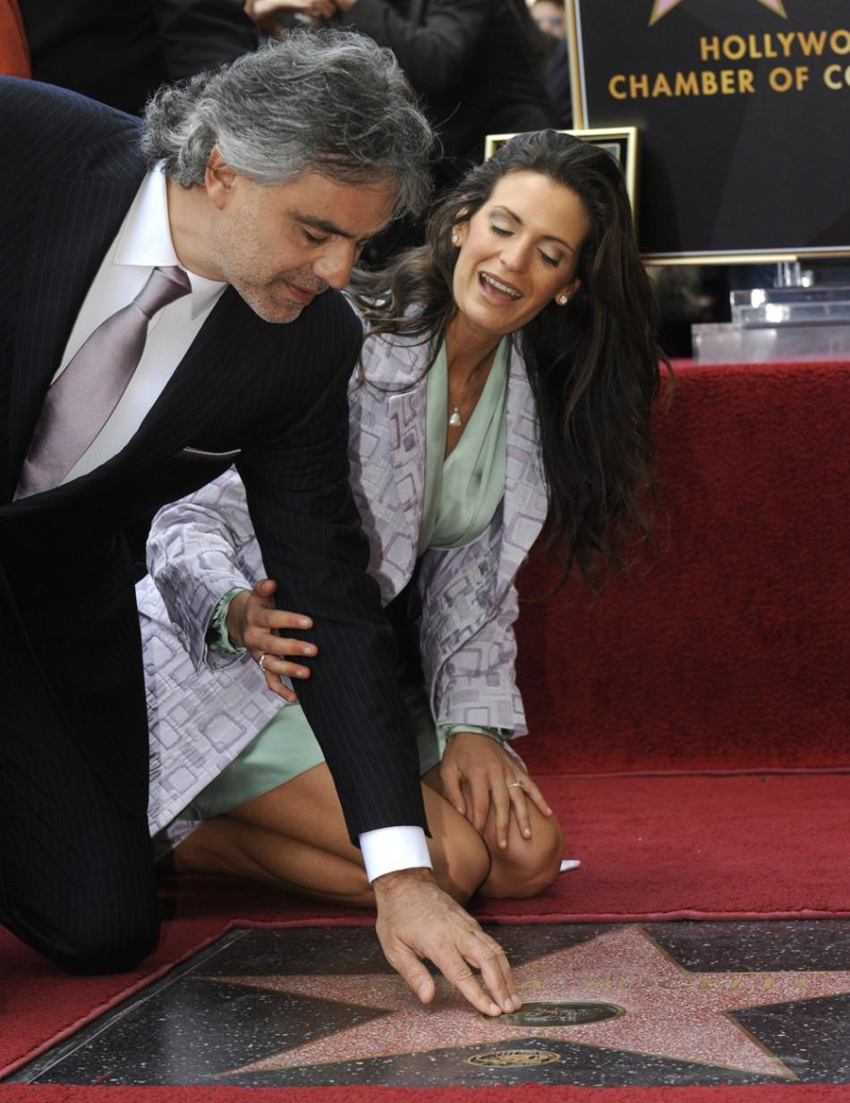 Italian pop tenor Andrea Bocelli (L) and Veronica Berti