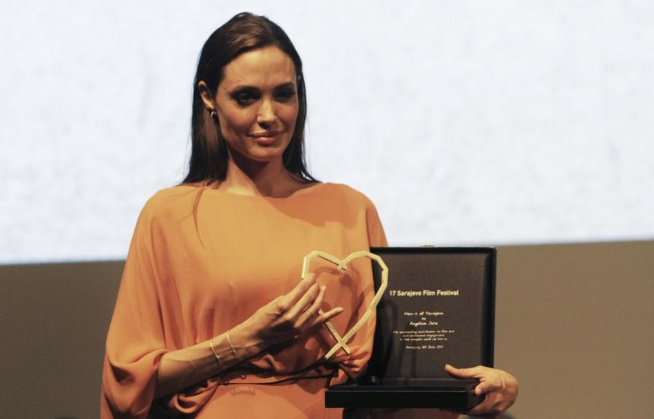 Angelina Jolie poses with the Heart of Sarajevo award which she received during the 17th Sarajevo film festival