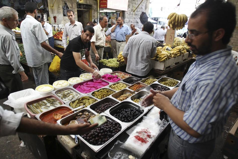A man sells pickles ahead during a preparation for the Muslim holy month of Ramadan, at the downtown market area in Amman