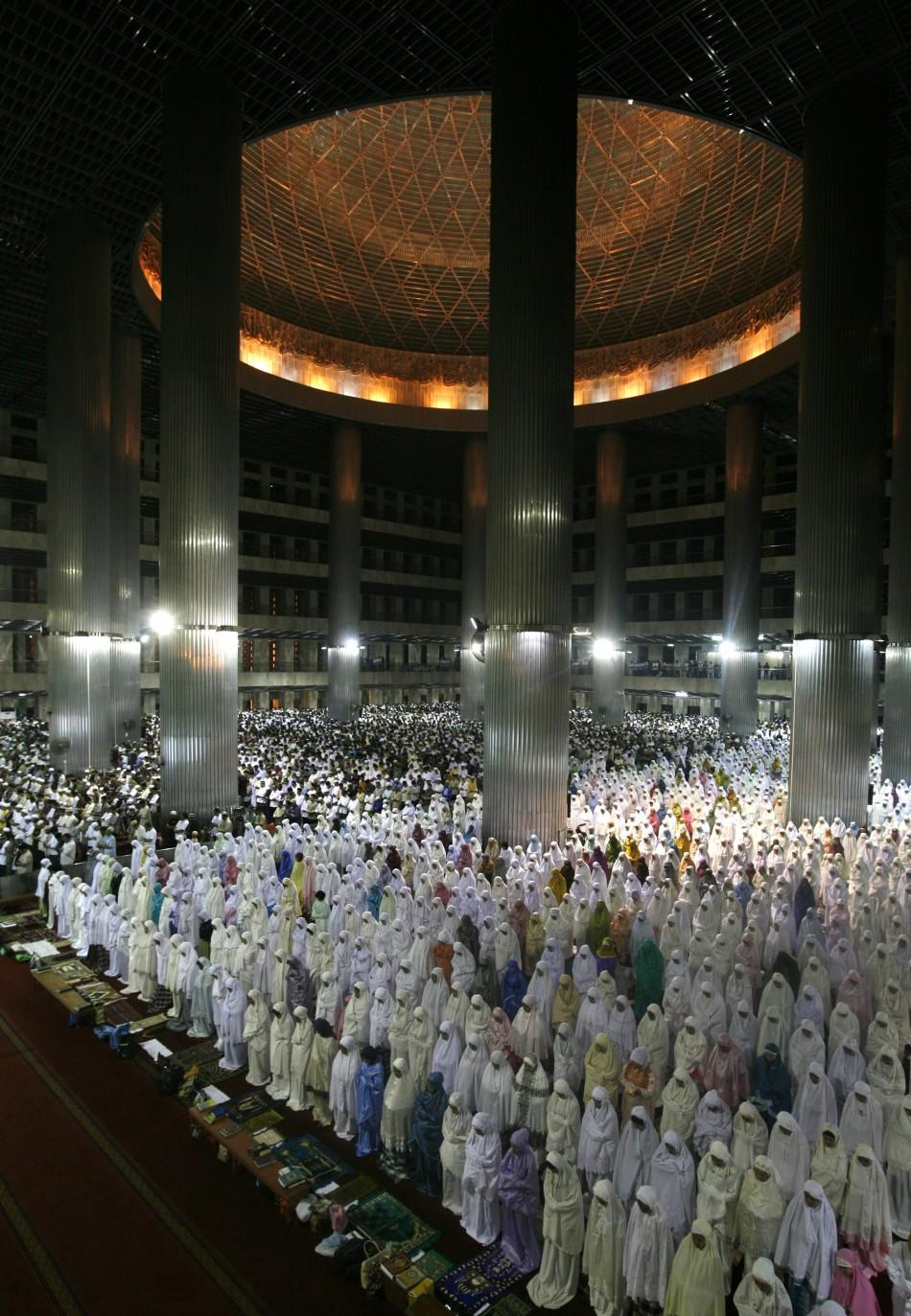 """Muslims attend mass prayer session """"Tarawih"""", which marks the beginning of the holy fasting month of Ramadan, at Istiqlal mosque in Jakarta"""