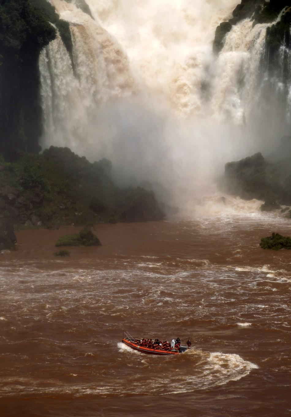A boat carrying tourists sails by the Iguazu Falls on the border of Argentina's province of Misiones and Brazil's State of Parana.