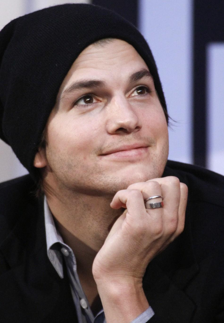 Ashton Kutcher reacts during an interview in a shopping centre in Pasching some 180 kilometres (some 112 miles) west of Vienna