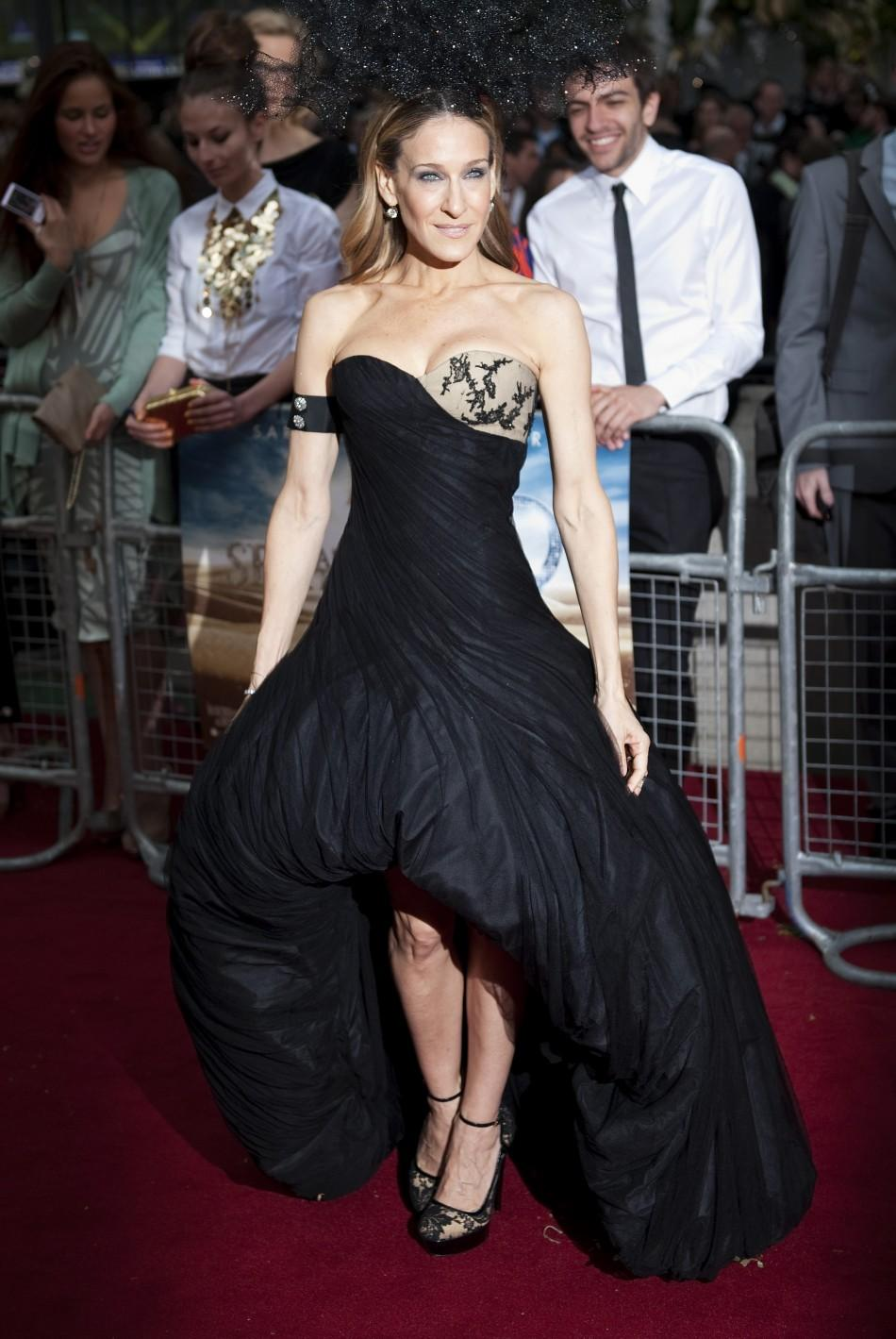 "Actress Sarah Jessica Parker poses for photographers at the premiere of ""Sex and the City 2"" in Leicester Square, London"