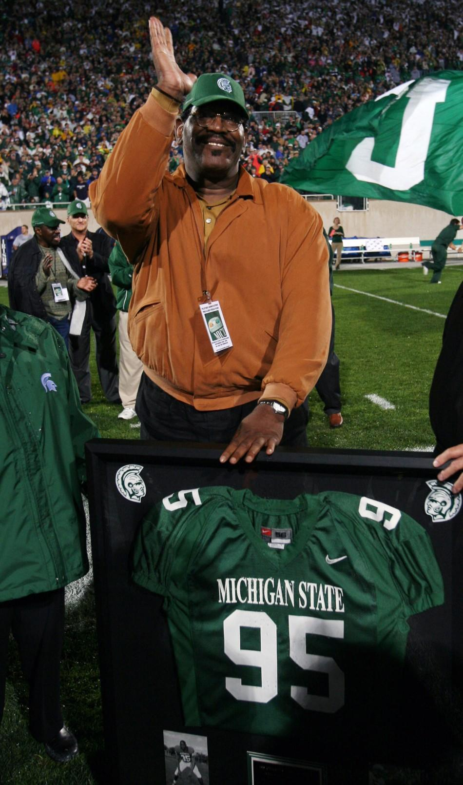 Former Michigan State football player and actor Smith reacts to having his jersey number retired in East Lansing Michigan