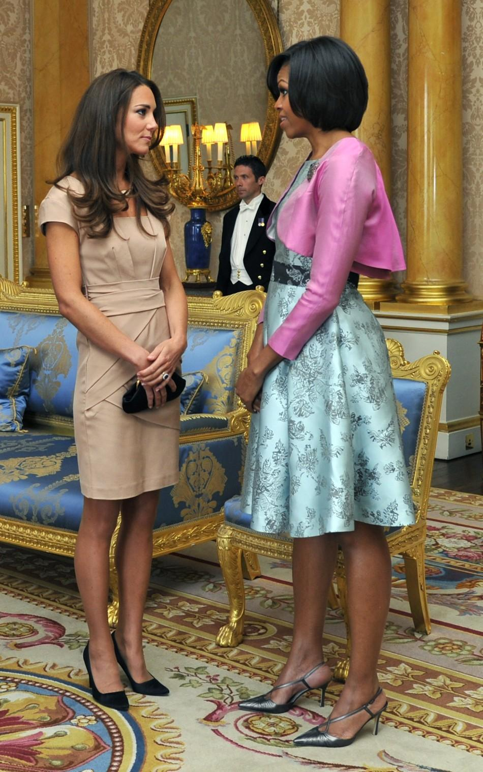 Last year's winner, U.S. first lady Michelle Obama speaks with Middleton