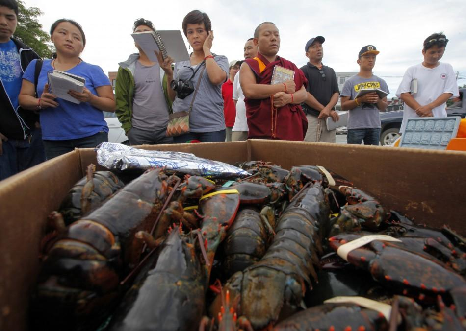 "Buddhists pray before releasing lobsters back into the ocean during ""Chokhor Duchen"" in Gloucester"