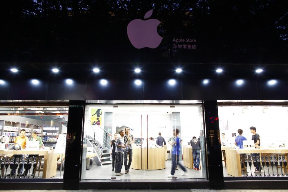 Customers and employees are seen from the exterior of a fake Apple Store in Kunming, Yunnan province July 22, 2011