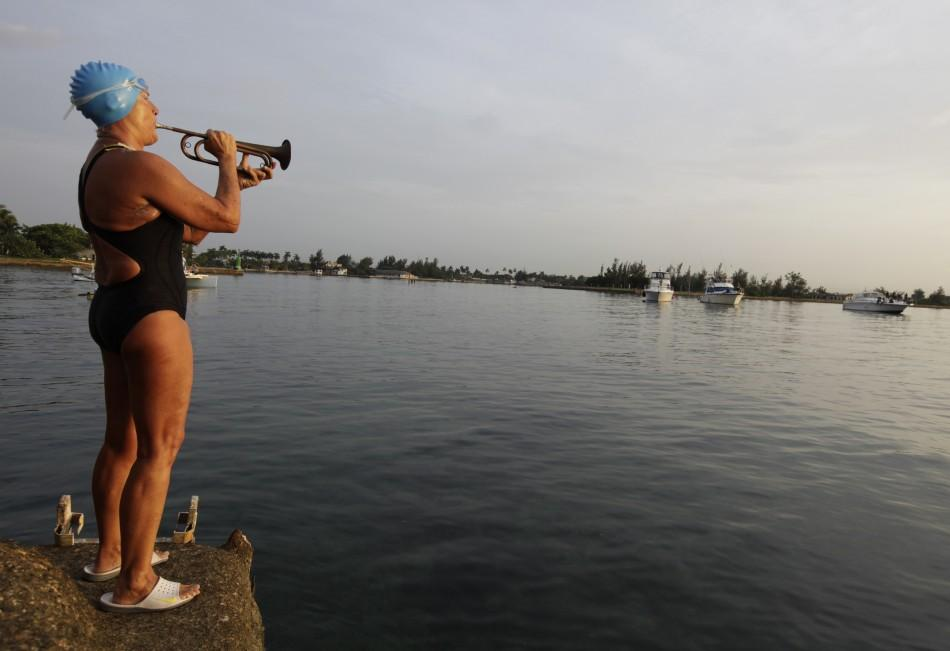 U.S. swimmer Nyad plays a trumpet before attempting to swim to Florida from Havana.