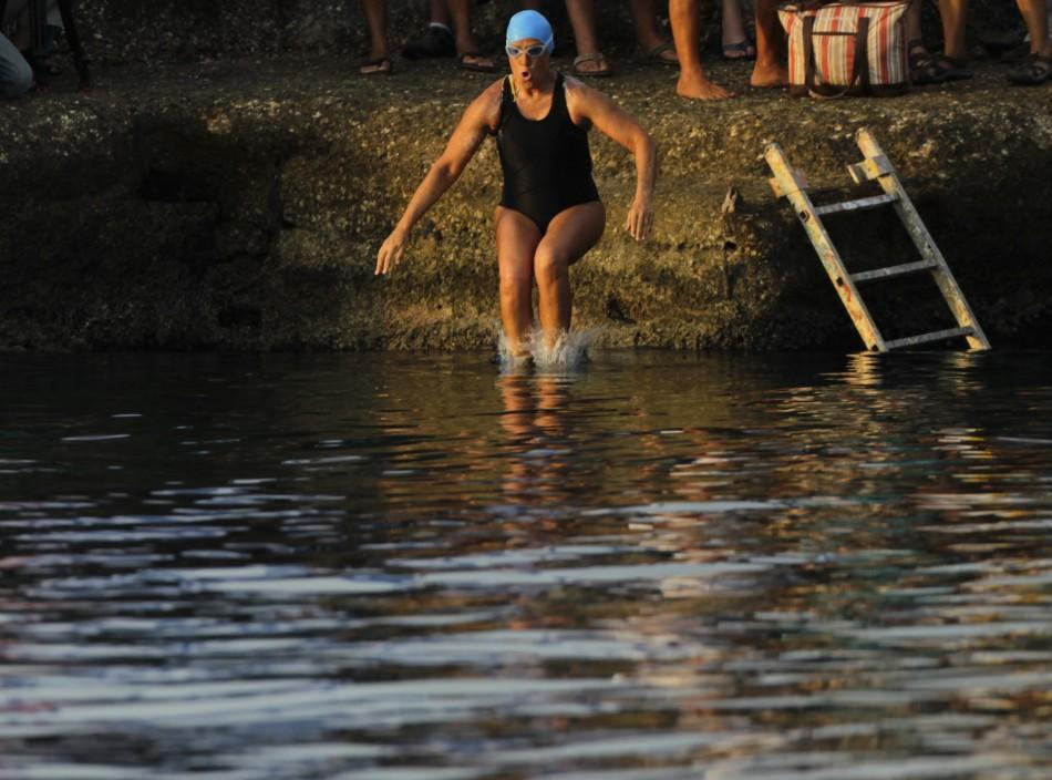 U.S. swimmer Diana Nyad jumps into the sea as she begins her attempt to swim to Florida from Havana.
