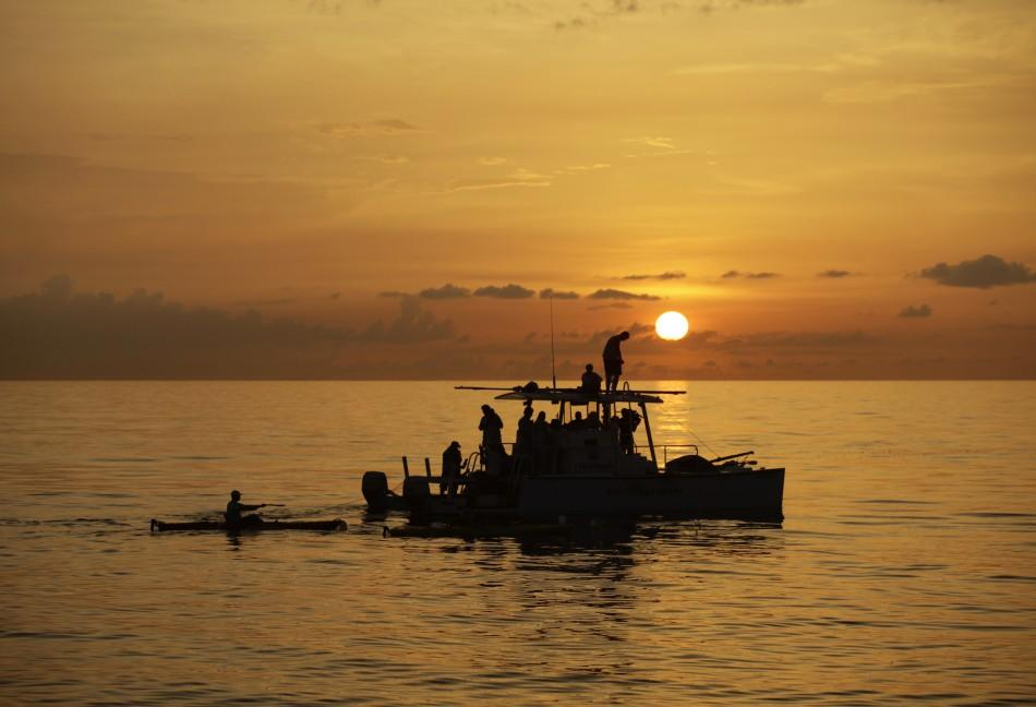 The sun sets as an assistance boat follows U.S. swimmer Diana Nyad during her attempt to swim to Florida from Havana.