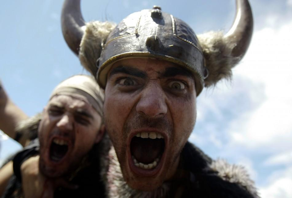 Men dressed up as Vikings take part in the annual Viking festival of Catoira in north-western Spain