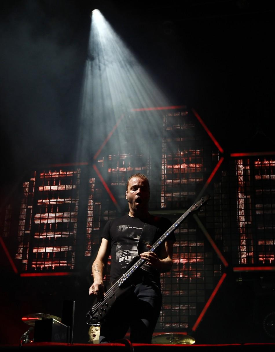 """Christopher Wolstenholme of the band """"Muse"""" performs at the Lollapalooza music festival in Grant Park in Chicago"""