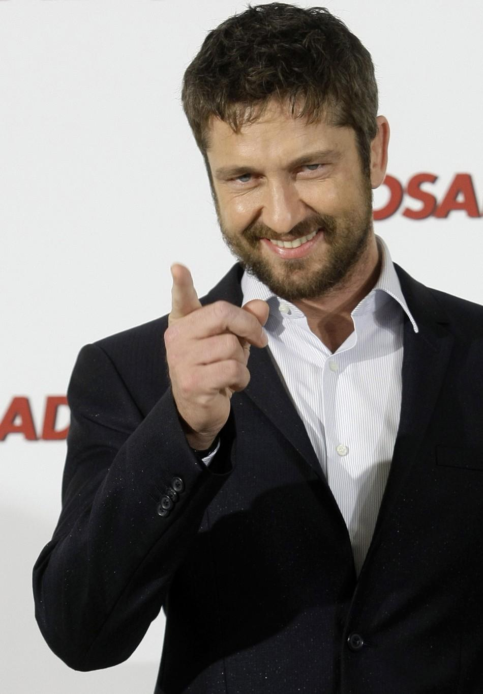 Actor Butler poses during a photocall to promote the movie The Bounty Hunter in Madrid