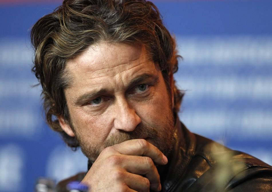 Actor Butler attends news conference at the 61st Berlinale International Film Festival in Berlin