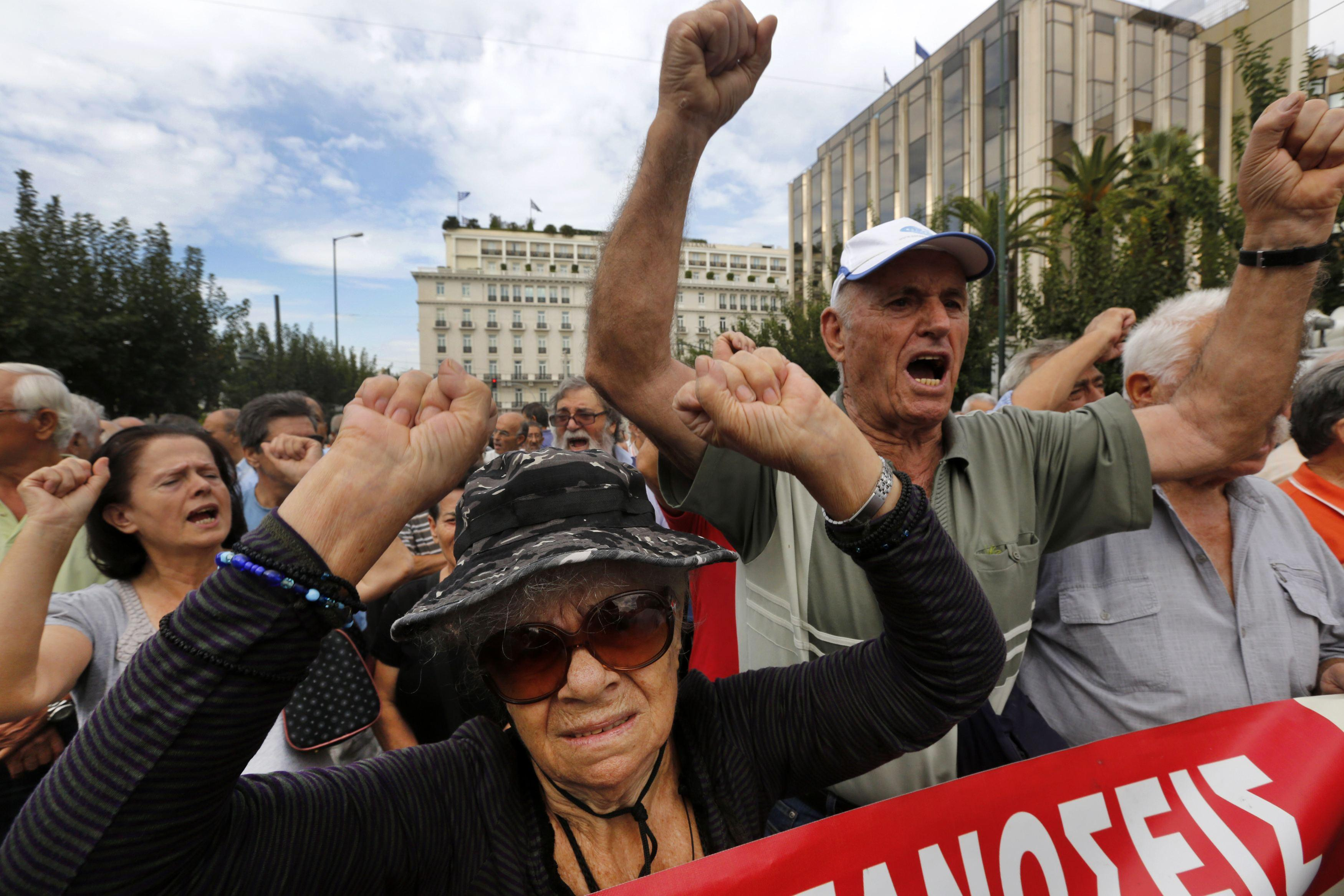 Retirees chant during a march against austerity measures in Athens on October 8.