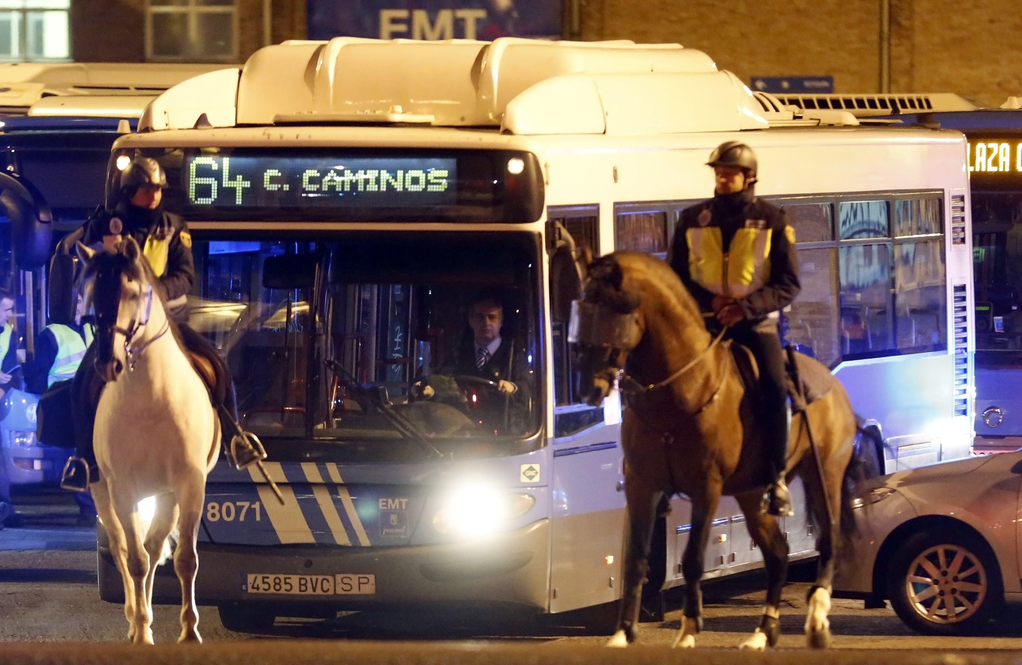 Mounted police escorted a public bus along its route.