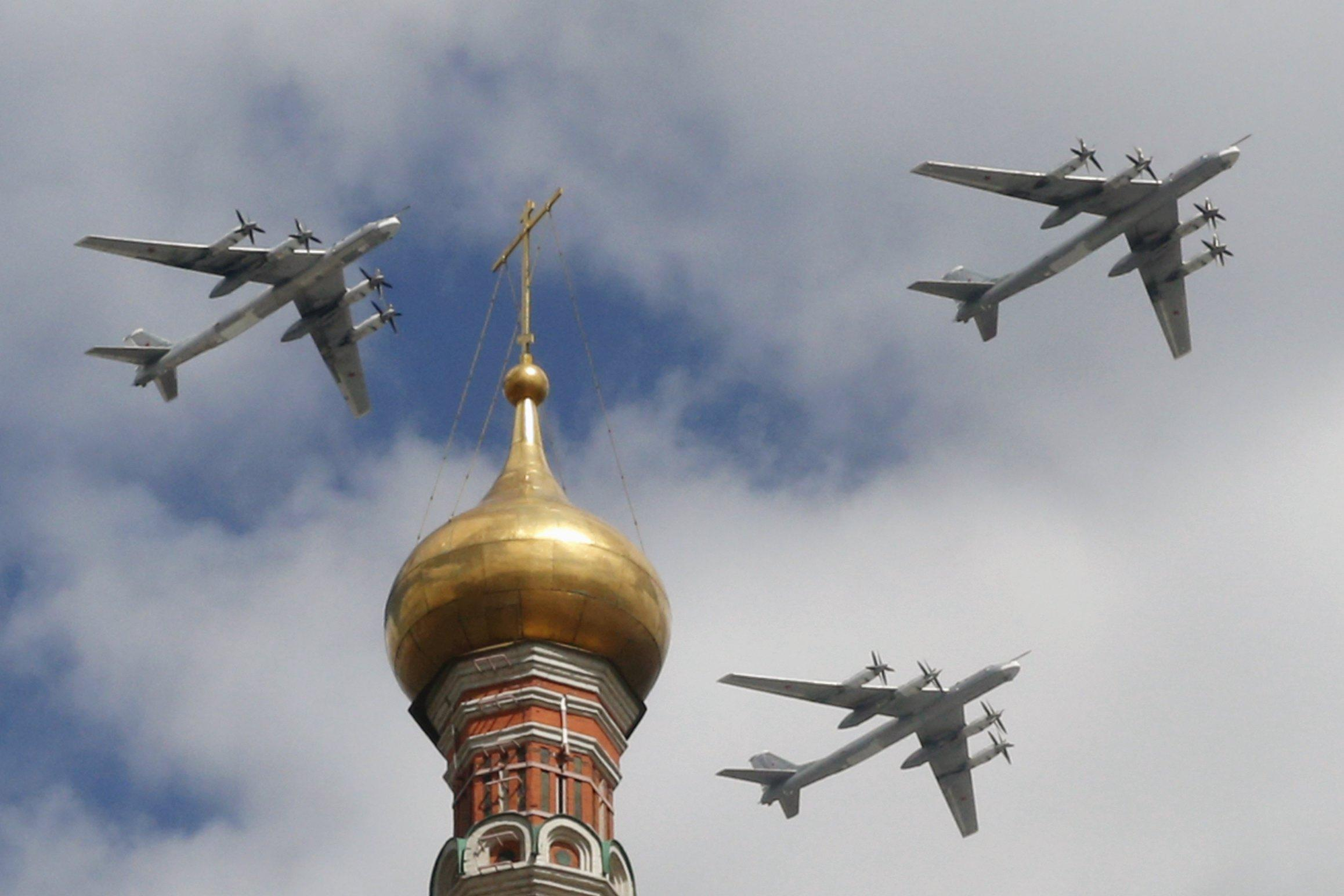 Russian bombers fly in formation over Moscow.