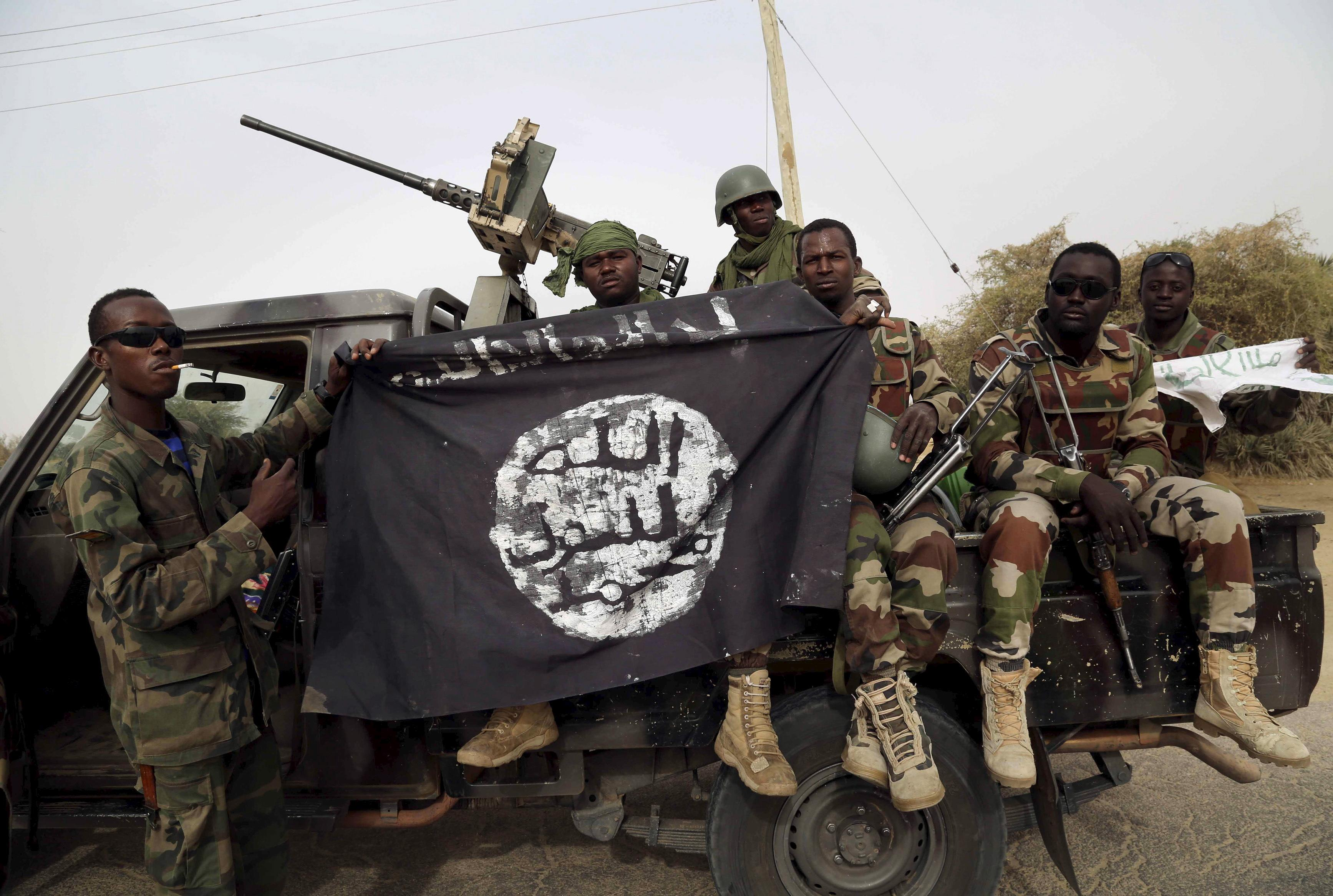 Nigerian soldiers hold Boko Haram flag